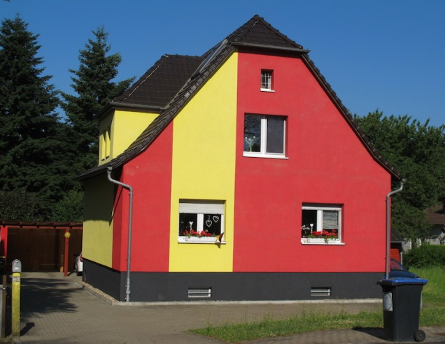 A colourful village house.