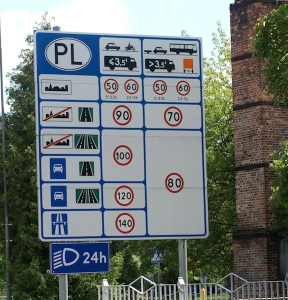 Polish road authorities making sure visitors to Poland understand the road rules. Note that vehicle lights are required to be on during both day and night.