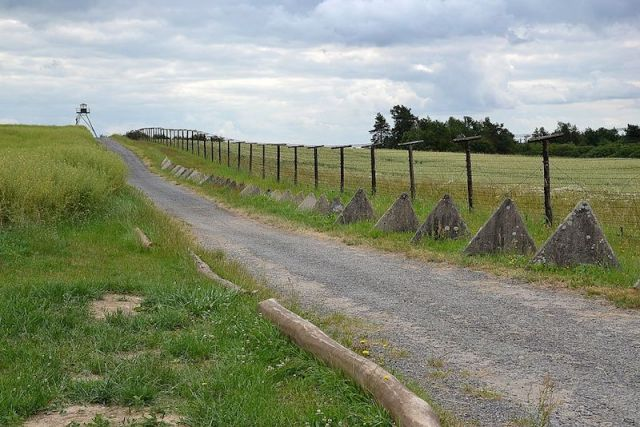 Preserved part of the Iron Curtain in the Czech Republic. The concrete pyramids are tank traps. Image by Marchin Szala via Wikipedia. To see more of Machen's work search Pudelek.