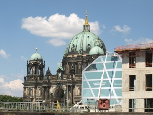 The new encroaching on the old.  The old here is the Berlin Cathedral.