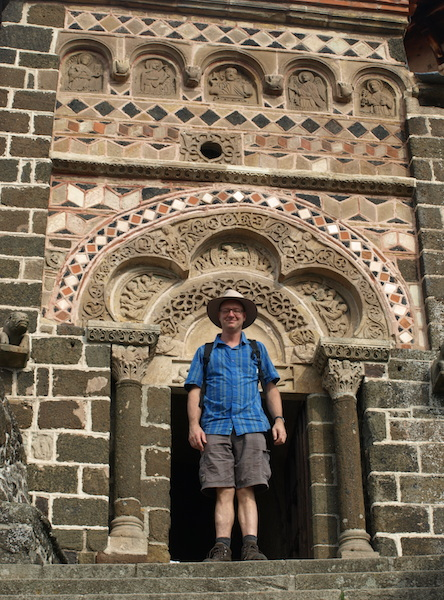 Friend Thomas at the entrance to Chapel of Saint Michel d'Aigulhe, where many pilgrims set off on their walk.