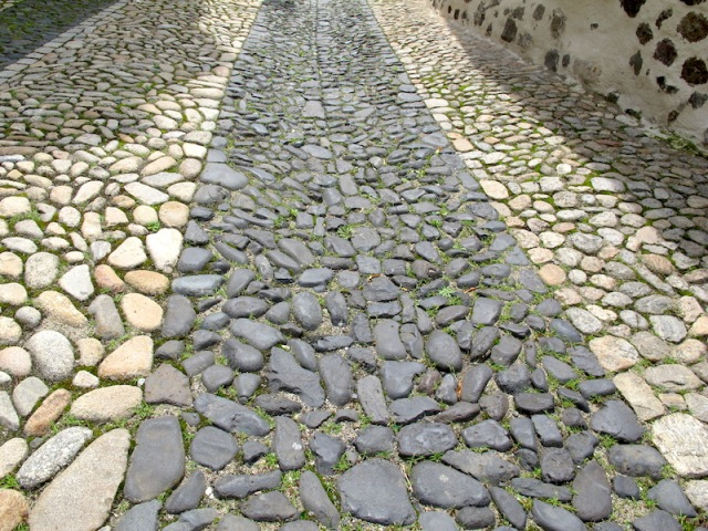 Path on the way down from Chapel of Saint Michel d'Aigulhe . Waterworn cobblestones were used for pathways as they were inexpensive and their shape enabled horse and donkey hooves to grip.