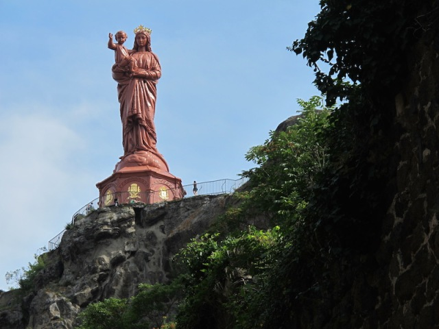 Statue of Notre-Dame de France standing on Corneille Rock.