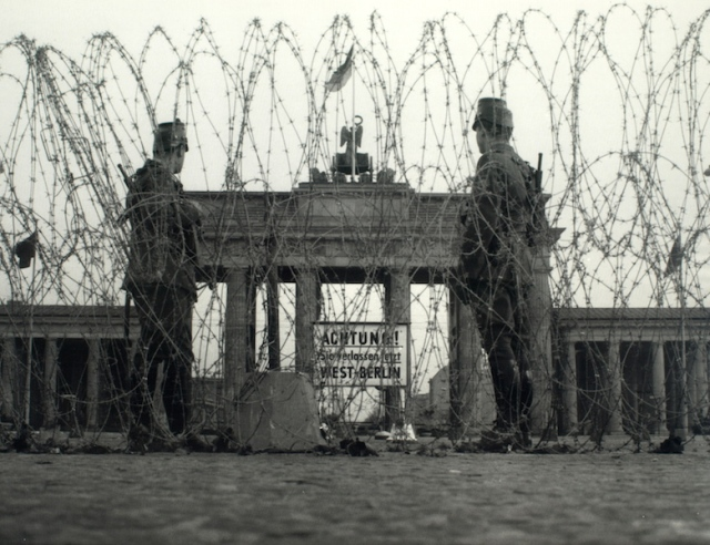 Guards at the gate during the dark years. For twenty eight years (1961 to 1989) the gate was within no man's land. Photo from Spiegel online.