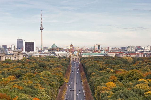 Tiergarten within the borough of Mitte in central Berlin. Portion of the Berlin cityscape in the distance. Photo by A. Savin via Wikipedia