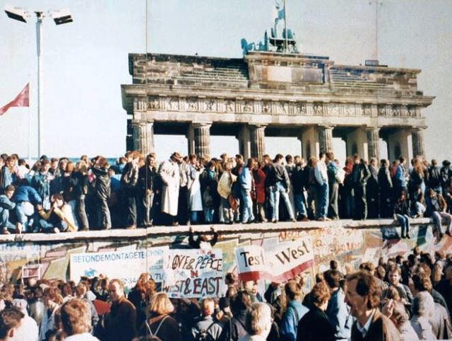 The Berlin wall in front of the Brandenburg Gate in 1989 just prior to its fall. Photographer unknown.