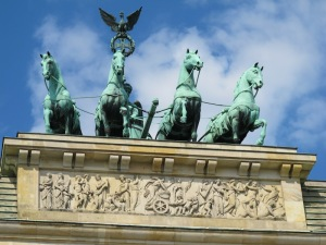 The Brandenburg Gate quadriga photographed through the crack in the security screen.