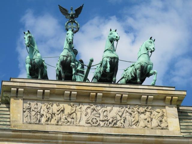 The Brandenburg Gate quadriga photographed through the crack in the security screen.