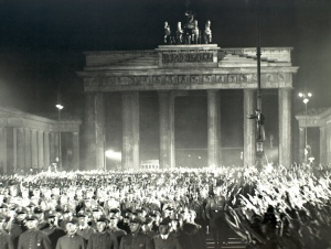 Brandenburg Gate during WW2.  The Nazi masses passing through the gate.