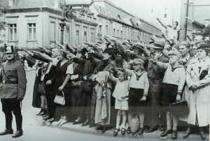 Berliners giving the German salute.  Note the lady (extreme right of image) not holding her hand high nor looking all that impressed.