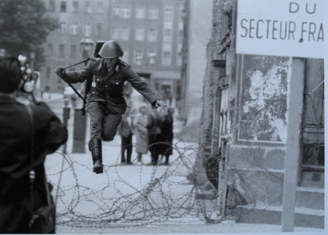 Conrad Schumann (1944-1988) an East German guard leaping the wire three days after it was erected. Image copyright Peter Leibing.
