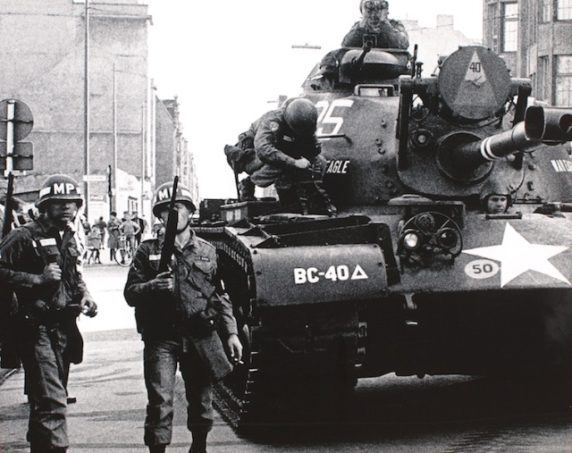 American tank at the Checkpoint Charlie standoff. Photo of a wall poster near Checkpoint Charlie. Photographer unknown.