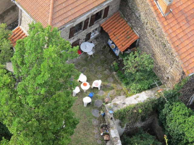 Looking down into a backyard from part way up the steps to the Chapel of Saint Michel d'Aigulhe.