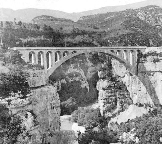 Massive segmental arch of the Pont du Moulin des Pierres bridge near Montanges over the Valserine River in the Haute-Jura France. Image: Copyright free.