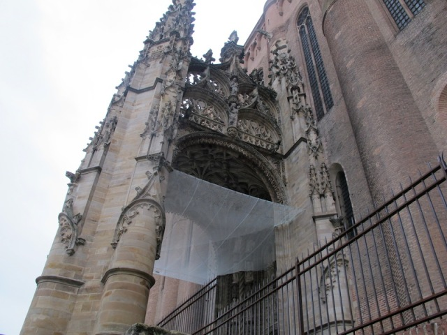 The entrance to the Albi cathedral. The screen is to either catch pigeon droppings or pieces of falling masonry.