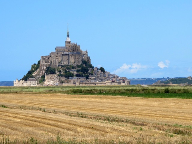 Mont St Michel surrounded by wheatfields, sea and history.
