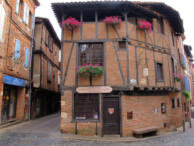 Half-timbered terracotta brick infill house in the medieval town of Albi.