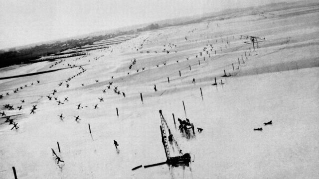Nazi soldiers involved with building defenses running for cover from low flying Allied aircraft. Photo credit AP from http://vcepinc.org