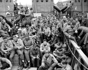 U.S. servicemen attend a Protestant service off the French coast aboard a landing craft before the D-Day invasion.  Image credit: AP Photo/Pete Carroll from http://vcepinc.org