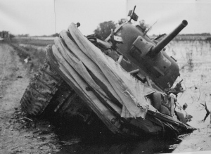 Bad news!  An Allied tank in an embarrassing position on the edge of the marshlands.   Image from open-air exhibition Utah beach.  Photographer unknown