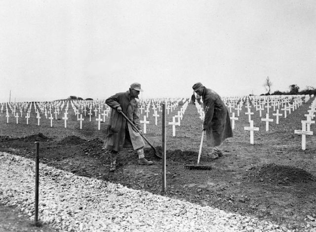 German prisoners of war working in an Allied cemetery Normandy after the D-Day invasion. Photo credit: AP via via http://vcepinc.org web page