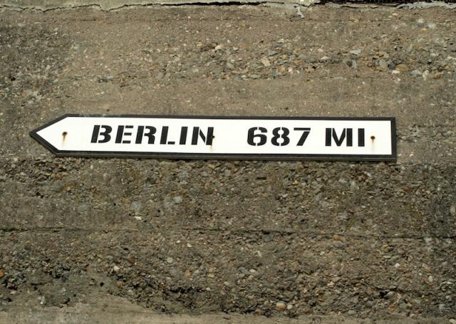 Sign on a bunker at Utah Beach. Berlin1105 kilometres.