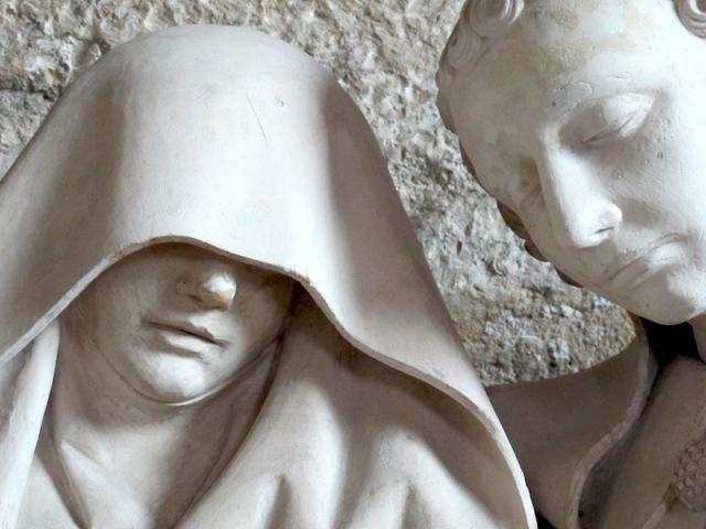 Veiled figure.
