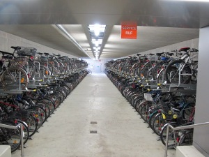 An unbelievable undercover bike storage near Zurich.  The upper bikes are on a cantilever system which delivers the bike to ground level when pulled.