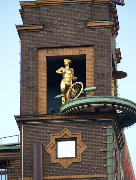 The 'Golden Cycling Girl' near the Tivoli. Artist Einar Utzon-Frank (1888-1955).