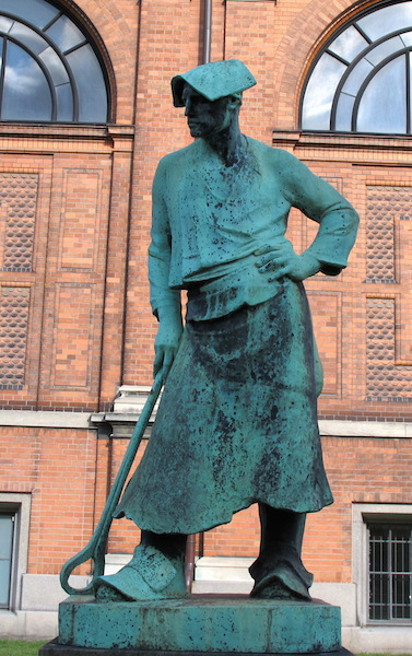 I'm guessing this sculpture depicts a foundry worker.