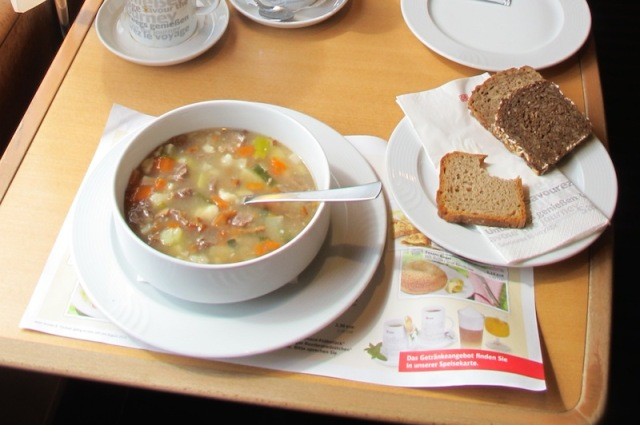 Thick chicken vegetable soup and black bread from the dining car kitchen en route to Munich. This soup set the standard