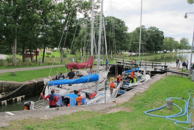 Yachts passing through one of the fifty-eight locks on the Gota Canal.