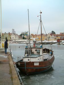 Ice locked vessel 2006.  I am seen here talking to the vessel owner who was standing on the ice and cleaning the hull.