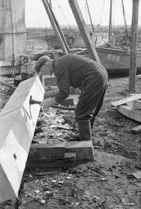 Squaring the keel for a fishing trawler UK.   This image was placed on Wikipedia by the Imperial War  Museum and is in the public domain.