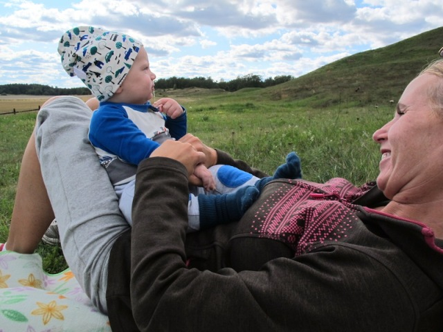 Sara, contemplating one of Sweden's newest Vikings (her son Oskar) and Oskar contemplating the Kings' Mounds.