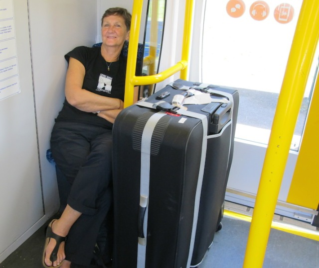Bev with her bike case on the train in Sydney.