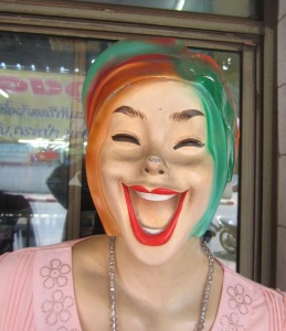A Thai mannequin demonstrating a Thai smile.