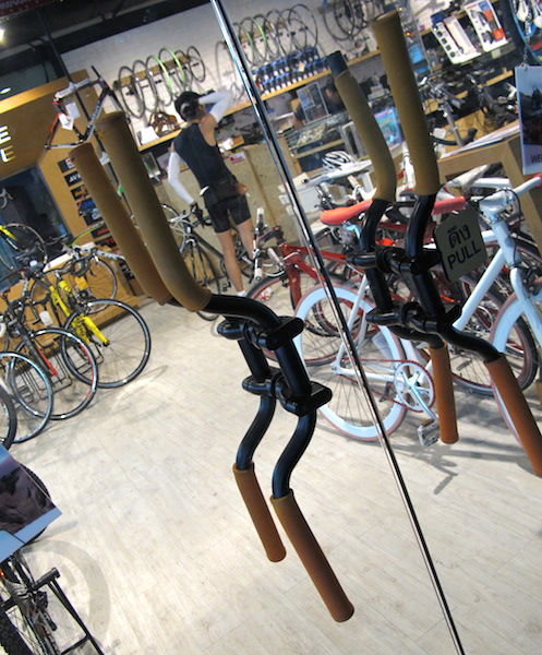 Creative door handles (bike handlebars) on one of the bike shops in Bangkok.