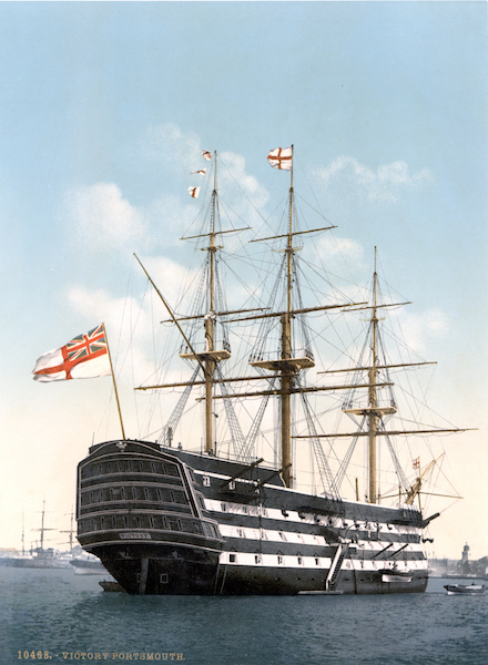 HMS Victory. The flag on top of the mainmast is the St George Cross and the flag on the bow is the Royal Naval Ensign. Image credit: Copyright expired author unknown from Wikipedia