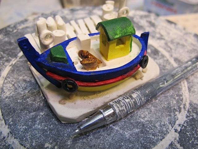A recent ceramic reproduction of a Greek fishing boat.