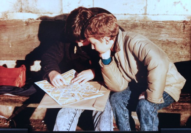 A couple of young travellers studying a map of London 1988.
