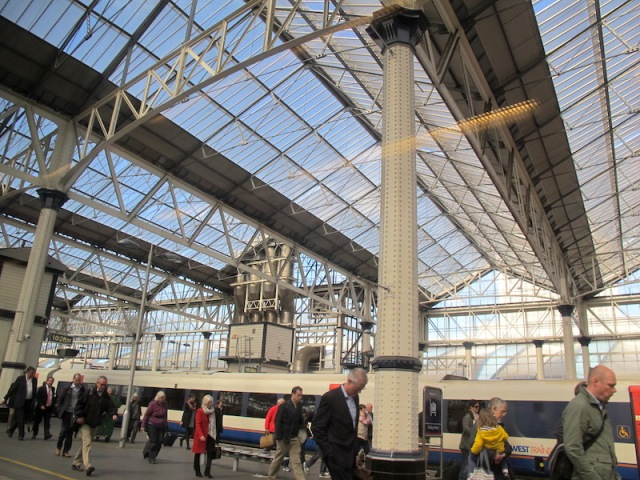 Arches of Waterloo Station. Why is it that all these commuters are looking down? Are they dreaming of exotic places beyond Waterloo?