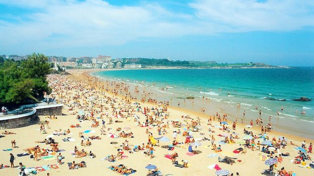 One of the fine sandy beaches around the Bay of Biscay. Image credit: from a poster in Santander.
