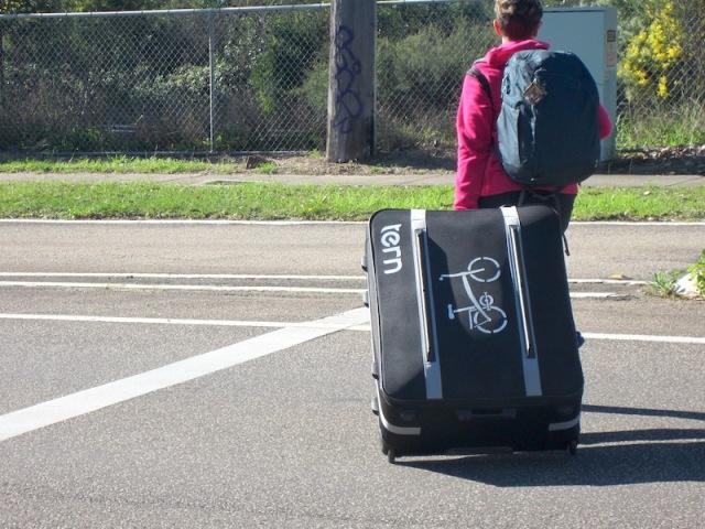 Bev pulling the bike case to Mt Kuring-gai station.