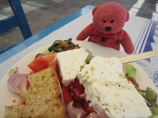 A memory of TBear, eyeing a Greek salad on the island of Kythera in 2014.