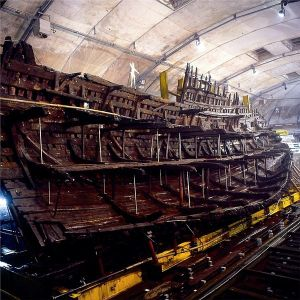 Portion of the HMS Mary Rose raised to the vertical and sitting on a steel cradle.  Image courtesy of the Mary Rose Trust.