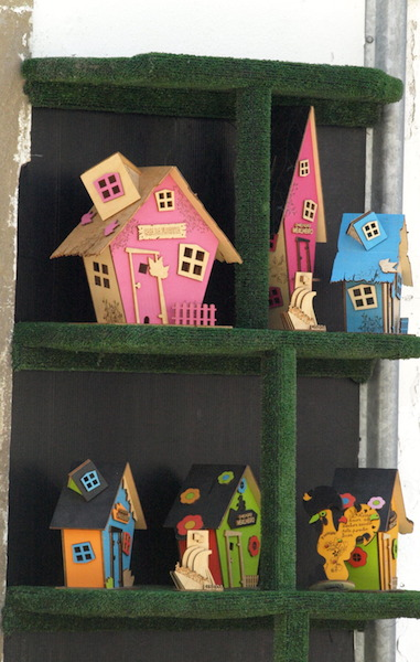 Very cute abstract houses made from plywood.