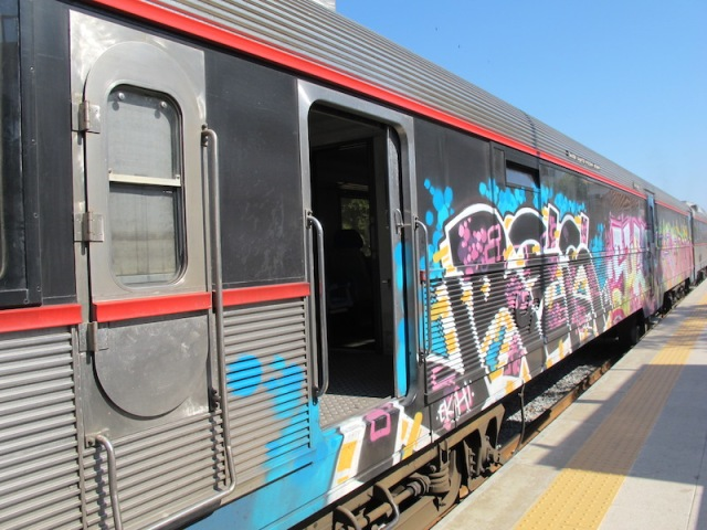 Graffiti on the windows of the train to Tavira.