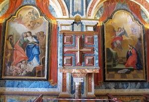 The painted pulpit inside San Sebastian church.