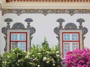 A close up view of the beautiful tiles on the front wall of the Pergola B & B.